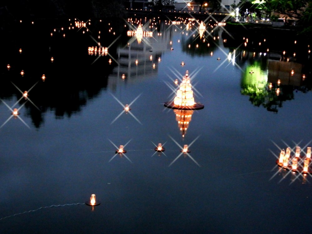 Lanterns floating in the castle moat
