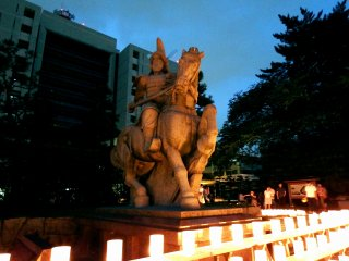 The statue of the first lord of Fukui Han (domain), Yuki Hideyasu, looks different tonight under the warm lights of the lanterns