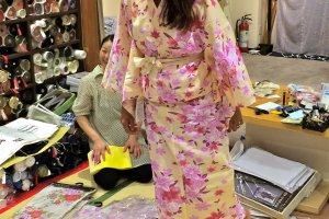Trying on a pair ofGeta, traditional wooden sandals, that were pre-packaged with the Yukata set at Nunoya.