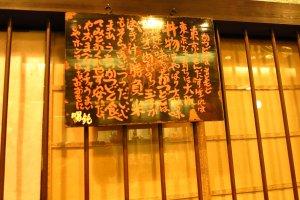 A blackboard menu hung outside an eatery