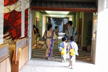 <p>A family going back to their room after taking a relaxing bath</p>