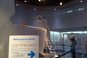 Visitors can use the feces hat and slide inside the huge toilet