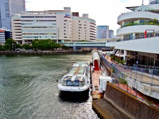 A 'Sea Bass' docked at its port alongside Yokohama's 'Bay Quarter' shopping center with theSogo department store in the background