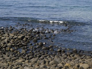 Low lapping sounds among the stones of the shore