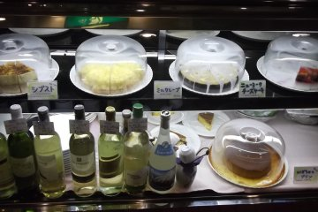 <p>Cakes and wine chilling at the front</p>