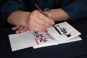 Notice the arm technique by this monk at Asakusa in Tokyo. He supports his writing arm while making sure he does not smear any ink onto stamps from other temples