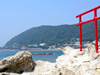 The torii gate at Isshiki Beach sits just on the rocky edge of the grassy isthmus