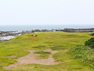 The grassy isthmus that separates the two, crescent shaped beaches of Isshiki