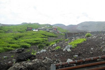 <p>Looking up at the various huts on Mount Fuji</p>
