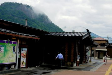 <p>Low cloud touches the rock face of Mount Iwadono</p>