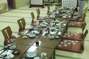 <p>The dining room set up for dinner</p>