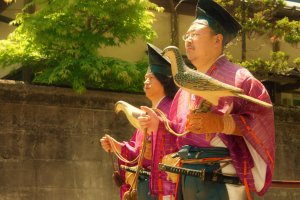 These men hold wooden birds representing traditional Japanese Falconry, or Takagari which is a practice that is associated with status and nobility.