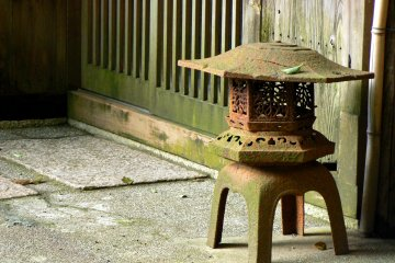<p>Attractive metal lantern with a patina of rust</p>