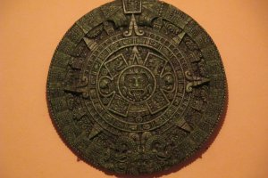 The Aztec calendar hangs on the wall
