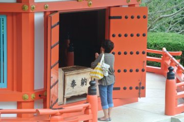 <p>At Aisendo&nbsp;shrine on Mount Nesugata, this modern girl is probably praying for romance</p>