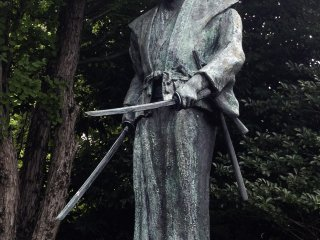 Statue of Miyamoto Musashi demonstrating his two-sword style of swordsmanship.