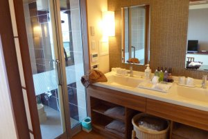 The bathroom has two sinks and a large shower that connects directly to the balcony and private hot bath!