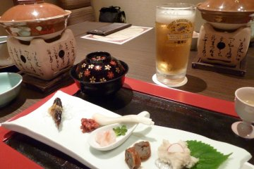 <p>Nothing feels better than a beer with local delicacies after a day of relaxing in the ryokan&#39;s hot springs</p>