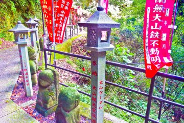 <p>A beautifully decorated bridge with many bright red banners near Oyama Cable Car Station</p>
