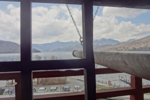 Pray for something and ring the bell three times. From the loft, you can see the lake and a beautiful mountain range beyond it.