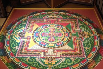 <p>The incredibly detailed sand painting</p>