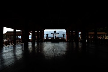 <p>Overlooking the high stage and the big torii gate from the main hall</p>