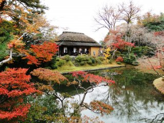 Part of the Katsura Imperial Villa is framed by autumn color