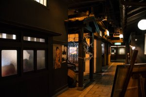 A stone walkway along the dimmed lanterns recreates the feeling of walking back in time through an old alleyway.