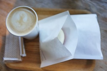 <p>A cup of hot caf&eacute; latte and a white-chocolate donut. Even the tissue is organic!</p>