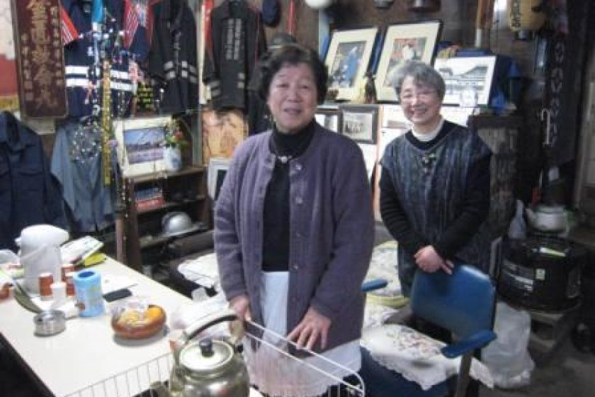 Makabe\'s smiling citizens welcome all comers with warm hospitality