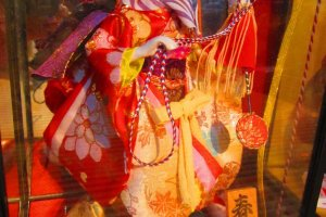 A Meiji era hina doll, still in its glass preservation case
