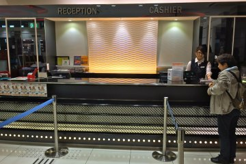 <p>The counter at Shidax. First time customer? Head to the &quot;Reception&quot; line.</p>