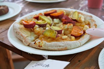 <p>Our homemade pizza consisted of apples, cream cheese bits, caramel syrup, and sweet potato picked from the farm</p>