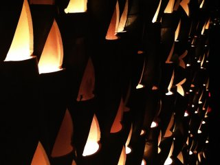 A closeup of the triangular cut-outs in the bamboo lanterns.