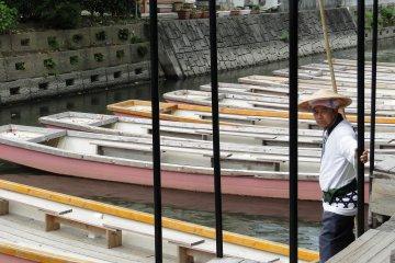 <p>A boatman waits for tourists</p>