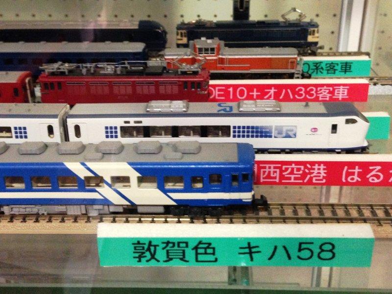 Miniature trains like theHaruka Kansai Airport to Kyoto Limited Express on display.