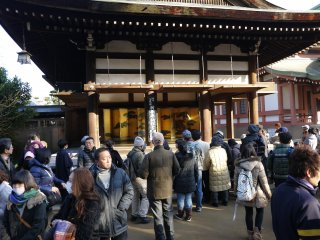 A crowd started to gather in front of the stage as the performance time drew near