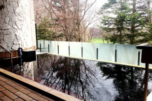 Relax in the hot spring onsen resort with a view of the forests at Kitahiroshima Classe Hotel