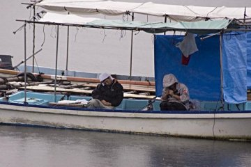 Fisherman take an afternoon nap in their boats