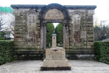 <p>A monument in the park across the street, built using stones from the old cathedral</p>