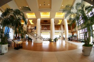 This is the grand lobby of the hotel with a beautiful marble staircase on the left side leading up to the second floor which is full of various restaurants.