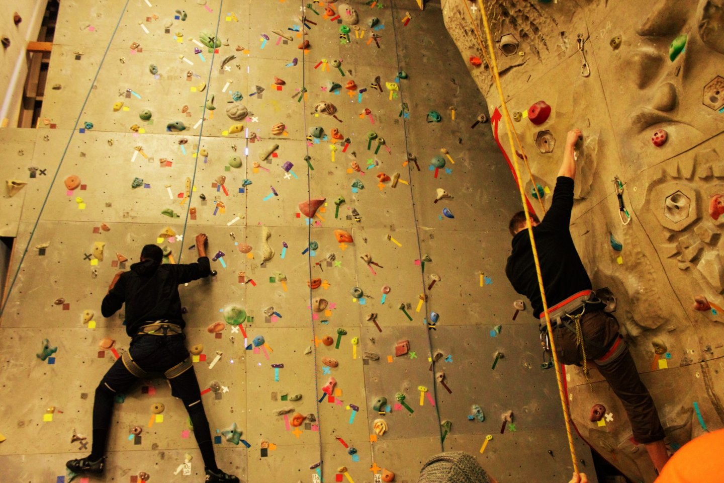Two climbers heading up the wall.