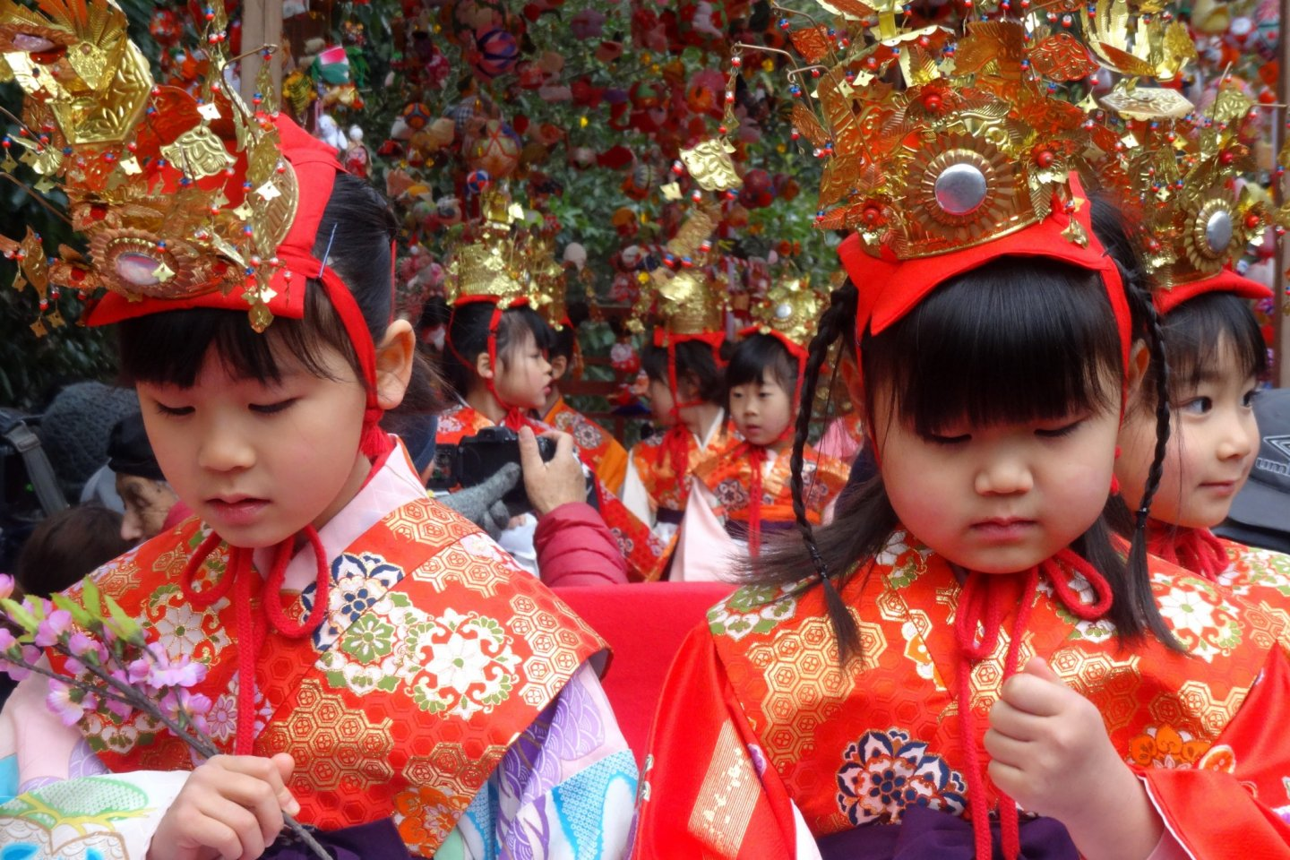 Young girls board floats for the opening parade of Yanagawa's Hina festivities