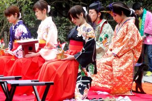 Locals dressed up as living figurines from a traditional Hina doll set