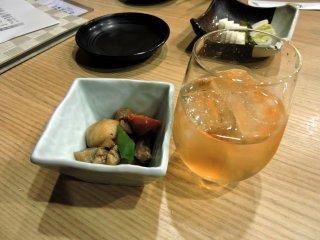 Umeshu (plum sake), an appetizer and Japanese pickles