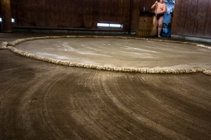 A skillfully swept Sumo ring closes their morning training session