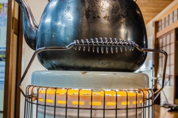 <p>A paraffin heater provides plentiful heat for the room and the tea!</p>