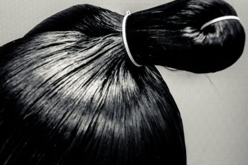 <p>Traditional sumo style hair</p>