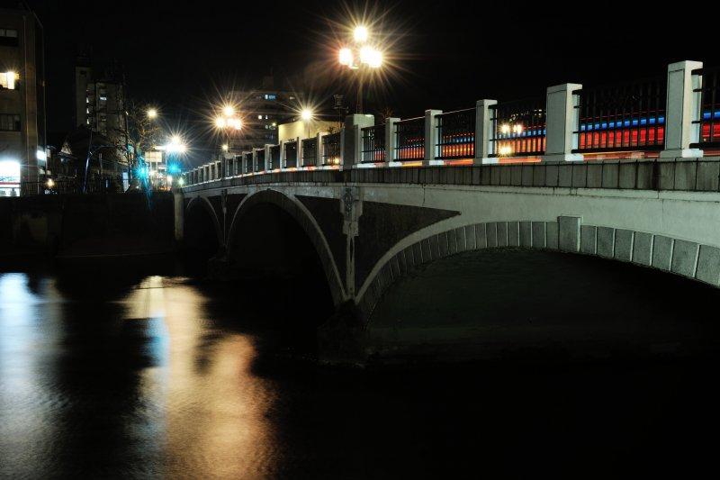 <p>Lamp light spilling from Asano River Bridge</p>