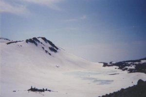 Thawing lake just below the summit